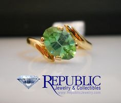 Green Tourmaline set into a 14 karat yellow gold bypass style mounting, only $295!   (call us for more info toll free at 1-877-422-7979)