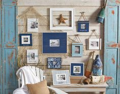 Love this gallery wall idea for the beach house! Cute teal and blue wooden picture frames