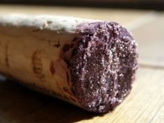 """Wine diamonds - Which acid causes """"wine diamonds"""" to form on the cork of a wine bottle and why is it important in wine making?"""