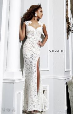 Sherri Hill 4316 is so stunning! This body hugging gown found in an ivory/nude is lace perfection! The whole gown is lace with a skirt that has a high slit to show off your awesome legs. The sweetheart top and cap sleeves add the girly twist that makes this gown fun for any occasion! Prom, pageants, and even as your wedding dress, this is flawless!!!