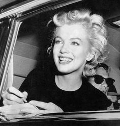 Marilyn signing autographs - 1954