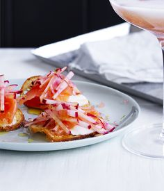 A recipe for a delightful smoked salmon crostini topped with goat's curd and pickled radish.
