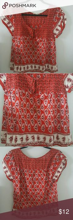 Red boho top This print is everything. 100% cotton. Lightweight. Ties in front with fun metal and copper thread accents. Box fit. Botton on top of each shoulder to gather short sleeves. Gently used condition. American Eagle Outfitters Tops Blouses