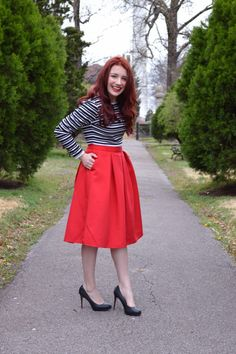 Outfit Idea: Red Midi Full Circle Skirt from Express with a Cropped Striped Pullover Sweatshirt and Retro Glasses Necklace