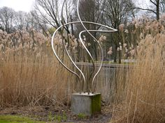 https://flic.kr/p/FSQ7tV   2016.04 - Amsterdam photo of Nature and Art, a reed bush in the park and a reflecting wire sculpture of Jan Wokers, location Oosterpark; geo-tagged free urban picture, in public domain / Commons; Dutch photography, Fons Heijnsbroek, The Netherlands   Amsterdam photo of the combination Nature & Art - reed bush in the park and a reflecting wire outdoor sculpture made by Dutch artist Jan Wolkers, located between the reed along the pond in the  Oosterpark, Amsterda...