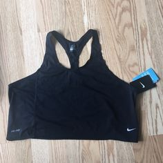 Nike Black Dri-Fit Loose Crop Top Large Nike Black Dri-Fit Loose Crop Top Large. Cute to wear over a colorful sports bra. Supposed to be slightly loose fitting. Nike Tops Tank Tops
