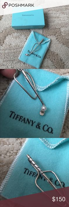 """Tiffany & Co. silver and pearl golf tie clip Vintage and hard to find. Sterling silver golf club and pearl golf ball. Would make a great gift for a golfer! Marked """"STERLING TIFFANY & CO."""" Comes with original box and bag. Great condition, no trades. Tiffany & Co. Jewelry"""