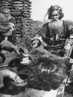Washing Mouth of Slain Bear is Part of Ainu Ritual of Worshipping New Bear God. Every scrap of the sacrificed bear would be reverently eaten, or repurposed. Nothing is wasted among the Ainu. (Premium Photographic Print by Alfred Eisenstaedt at Art.com)