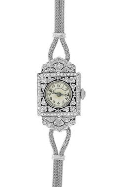 Edwardian Platinum, Diamond and Black Enamel Wristwatch, Tiffany & Co., with Double Strand White Gold Strap   Rose-cut diamond crown, dial signed Tiffany & Co., movement signed C.H. Meylan, c. 1915, strap added later. Length 5 3/4 inches.