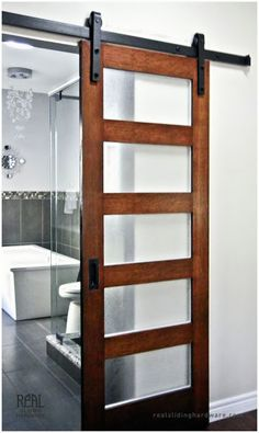 Its so open! Where to buy sliding barn door hardware Love this door. Its so open! Where to buy sliding barn door hardware was last modified: April… Sliding Glass Door, Doors Interior, Sliding Barn Door Hardware, Bathroom Decor, Interior, Bathroom Barn Door, Doors, Sliding Door Design, Panel Doors