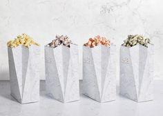 Spanish design studio Tatabi referred to the mythological home of the ancient Greek gods to design the branding and packaging for popcorn brand Diz-Diz