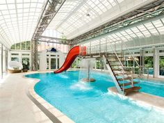 Indoor swimming pool with waterslide in Southampton, New York