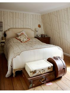 i love the vintage feel of this room and love the suitcases