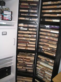 """tutorial for stamp shelving using a wooden crate, 1/4"""" dowels & 8.5"""" x 11"""" acrylic photo frames; she has several stacked on top of each other in the photo; each crate will hold 8 trays; tutorial here: http://papergoddess.typepad.com/we_will_always_have_paris/2007/08/rubber-stamp--1.html"""