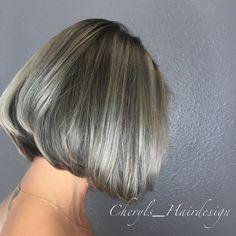 Silver hair with a short stacked bob haircut                                                                                                                                                                                 More