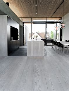 Grey wood floors going up to the walls and the kitchen island. Contemporary interior design.