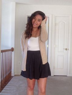 My outfit today, Brandy Melville skirts paired with a white tube top and a oatmeal colored sweater!