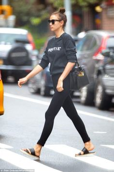 Irina Shayk wearing Celine Tilda Sunglasses, Hermes Black Kelly Bag and Prada Brigitte Bear Keychain