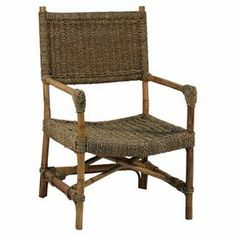 """Showcasing a woven seagrass design and natural finish, this lovely arm chair brings breezy style to your sunroom or den.  Product: ChairConstruction Material: Woven seagrassColor: NaturalDimensions: 36.5"""" H x 23.5"""" W x 21.5"""" D"""