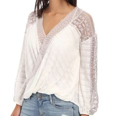 """Free People Valley City Top XS NWT White flowy top with mauve lace detailing. Pair with bell bottom jeans and leather sandals and you're set!  Fiber Content: 41% cotton/31% rayon/28% polyester   Measurements: bust 32"""", waist 25"""", hips 34"""".  No Trades Free People Tops"""