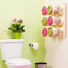 Upcycle your large coffee tins into towel holders :) So cute!