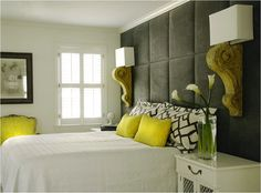 Yo! So cool - padded wall/headboard with fabulous corbel-sconces!
