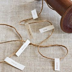 String Together a List of Blessings | Print out individual words on tabs, and fold them around twine. Weave the twine along the center of the table