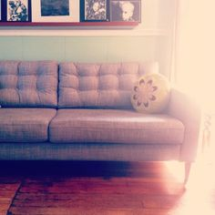 My So- Called Handmade Life: Sofa Hack, the Karlstad from Ikea with some great links for turned legs and DIY tufting