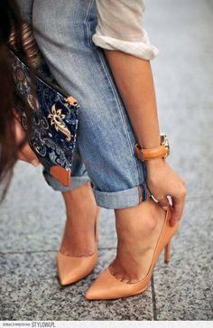 Neutral colored pumps paired with a comfy outfit of boyfriend jeans and button-down shirt