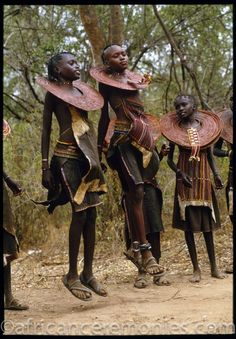 Newly initiated Pokot girls at the climax of the ceremonies of the rite of passage leap and shake their ornate beaded collars. Kenya | ©Angela Fisher and Carol Beckwith (African Ceremonies)