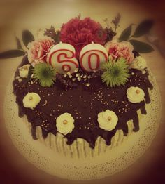 Cake for birthday with narural flowers cream and chocolate