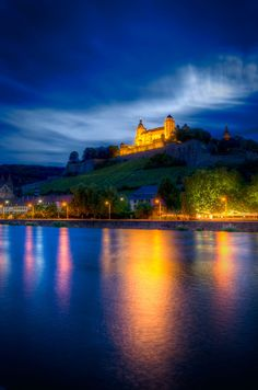 Fortress Marienberg in Würzburg, Germany, shot across the Main river at the blue hour by Klaus Hermann