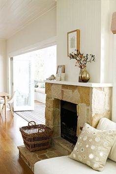 A warm, casual feel is created by the addition of a roughly textured sandstone fireplace.
