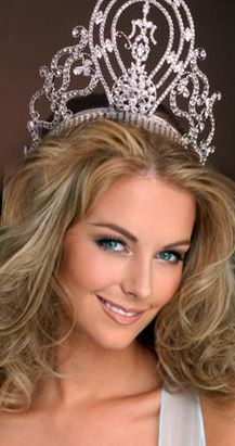 2004 Jennifer Hawkins (Australia)...(Jennifer actually never wore the traditional crown as shown, someone photoshopped it onto this pic...she actually wore the Mikimoto crown [2002-2007])
