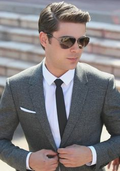 Zac Efron pulls off this look perfectly. It's smart enough for the office but the addition of a pocket square and sunglasses add a hint of style and individuality to the look. Business Hairstyles, Trendy Hairstyles, Hairstyles 2018, Fringe Hairstyles, Feathered Hairstyles, Wedding Hairstyles, Pixie Hairstyles, Bouffant Hairstyles, Wedge Hairstyles