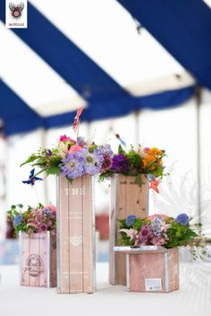 Awesome twist on boxes for the tables with flowers