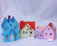 Printable Miniature Putz or Glitter Christmas Houses. You know the ones? Those old-fashioned cooler-than-cool houses?  Here are free printable plans for an entire village. No need to wait until Christmas!  This is a great project anytime.