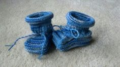 Mukluk baby booties. These can be made any size and in any color or multiple colors. Matching hats are available too.