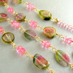 Watermelon Tourmaline Slice Necklace by SurfAndSand @ Etsy.  ($159)  Way expensive, but very pretty colors.  This shop has a lot of bright, attractive pieces.