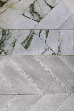 The 'Hungarian Point' pattern of the oak kitchen floor has been matched in marble for the larder floor, and the divide between the two marked with a brass strip.