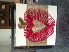 An apple for the teacher. Nails, thread & burlap on canvas.