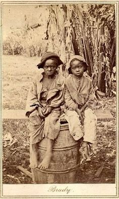 A testament to a dark part of American history. A 150-year-old photo found in a North Carolina attic shows a young black child named John, barefoot and wearing ragged clothes. Art historians believe it's an extremely rare Civil War-era photograph of children who were either slaves at the time or recently emancipated. It was accompanied by a document detailing the sale of John for $1,150.