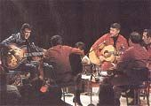 Elvis 1968 TV Special Clip. Jamming to his early Rock songs with his origianal guitarist, Scotty Moore, and drummer, D.J. Fontana. Great live action and nice guitar work by Scotty and Elvis..