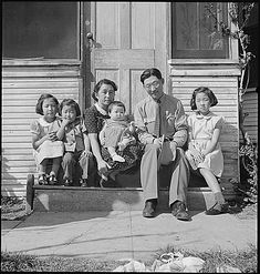 Mountain View, California. Henry Mitarai, age 36, successful large-scale farm operator with his family on the steps of their ranch home, about six weeks before evacuation. This family, along with others of Japanese ancestry, will spend the duration at War Relocation Authority centers, 1942, Dorothea Lange