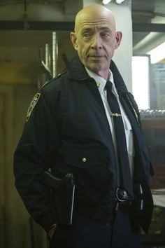 PLOT: When two cops are found dead, an FBI agent (Chadwick Boseman) seals off the 21 bridges leading in/out of Manhattan to catch the killers. Simmons plays a cop who helps out the agent because he has a vested interest in the case. Black Pather, Cops, Avengers, Raincoat, 21st, Leather Jacket, Bridges, Movies, Jackets
