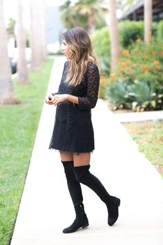 Ashley Torres is wearing thigh high boots in a classic style, paired with a lace blouse and with a matching black skirt. This look is ideal for the warmer fall days, but can easily be adapted with tights for a cooler temperature. Skirt/Top: Zara, Boots: Dolce Vita.