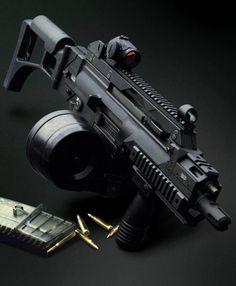 Heckler & Koch G36 assault rifle with 100 round C-Mag drum magazine: