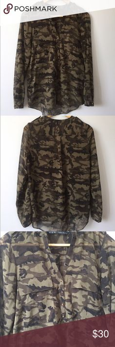 """Zara Basic Camo Print V-Neck Long Sleeve Shirt -Excellent used condition. -100% Polyester. -Sheer. -V-Neck. -4 Spike Button Closure. -Measurements are taken with garment laying flat:  Length: Approx. 25"""" (Top of the Shoulder to the bottom of the hem line).  Armpit to Armpit: Approx. 17"""" Zara Tops Blouses"""