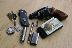 every day carry - Taurus .38 snub nose revolver (hornady critical defense rounds)     Zero Tolerance 0350 never leaves me daily      1854 Gold dollar money clip (with id)      Simple key ring with (titanium dog tag)      Zebra F-301 ball point pen      Ronson butane lighter      Eagletac d25c clicky titanium      HTC evo 4g     Usual suspect network challenge coin (code of bushido)