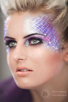 Gems accent a sparkly mermaid inspired fantasy make-up.